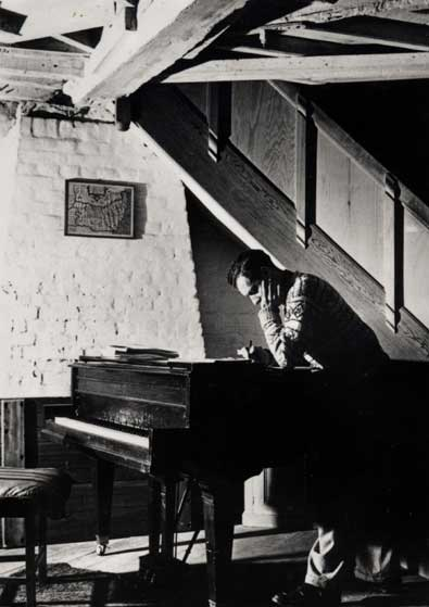 Britten at his piano